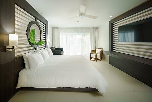 Ocean View Junior Suite King with Single Sleeper Sofa
